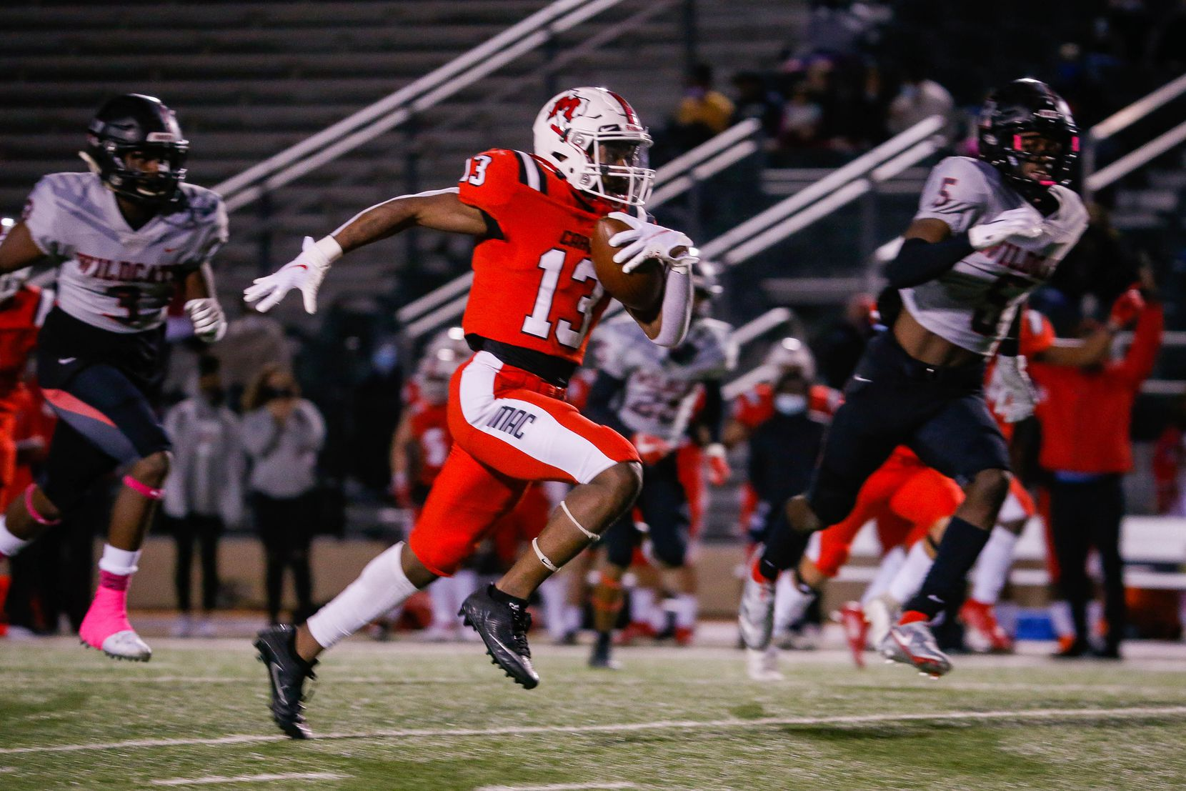 Irving MacArthur's Davison Morris (13) slips past the  Lake Highlands' defense for a touchdown during a the first quarter of a high school football game at Joy & Ralph Ellis Stadium in Irving on Friday, Oct. 23, 2020. (Juan Figueroa/ The Dallas Morning News)