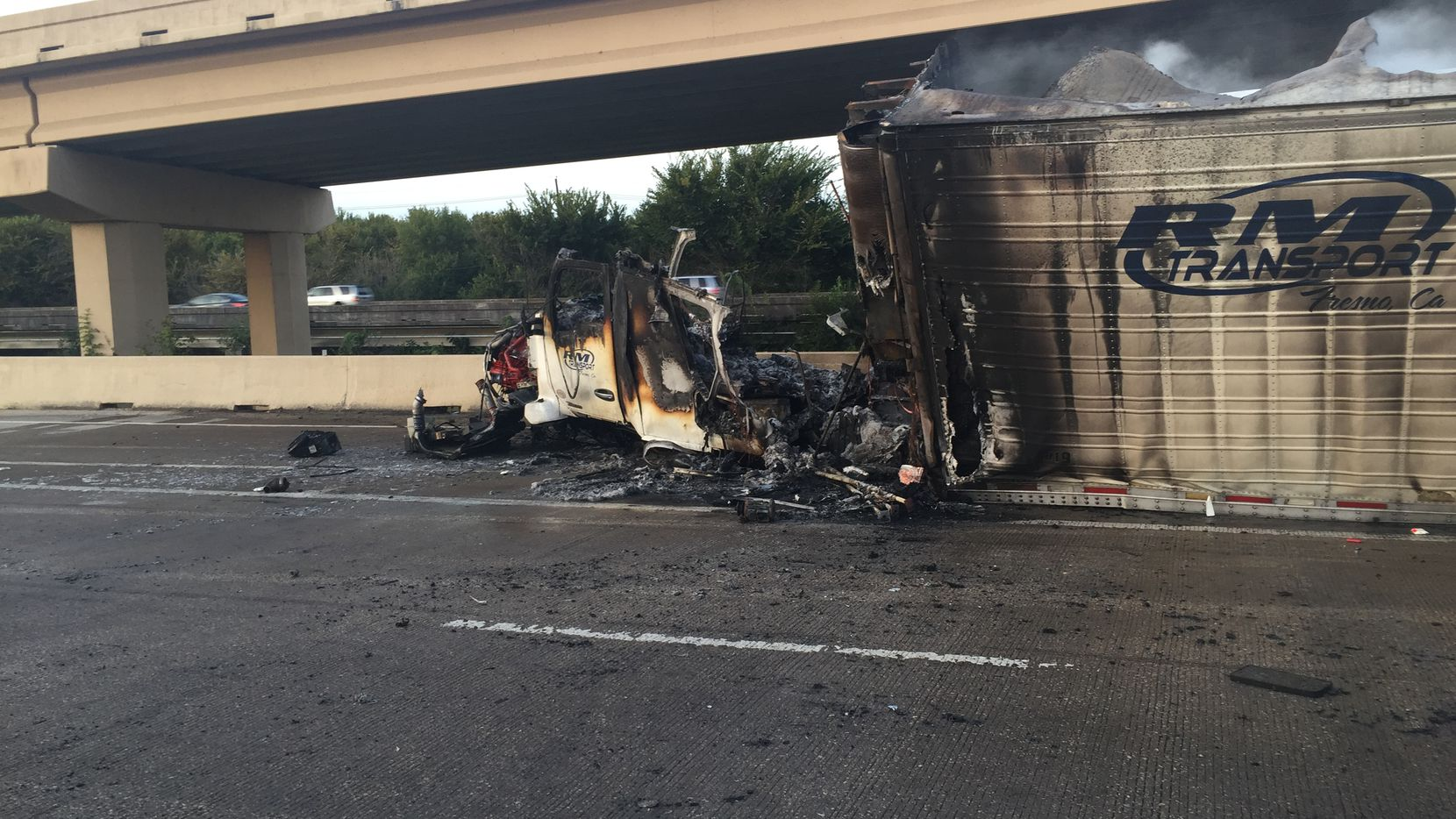 An 18-wheeler caught on fire after hitting the jersey wall on Interstate 35 near the exit to the President George Bush Turnpike in Lewisville.