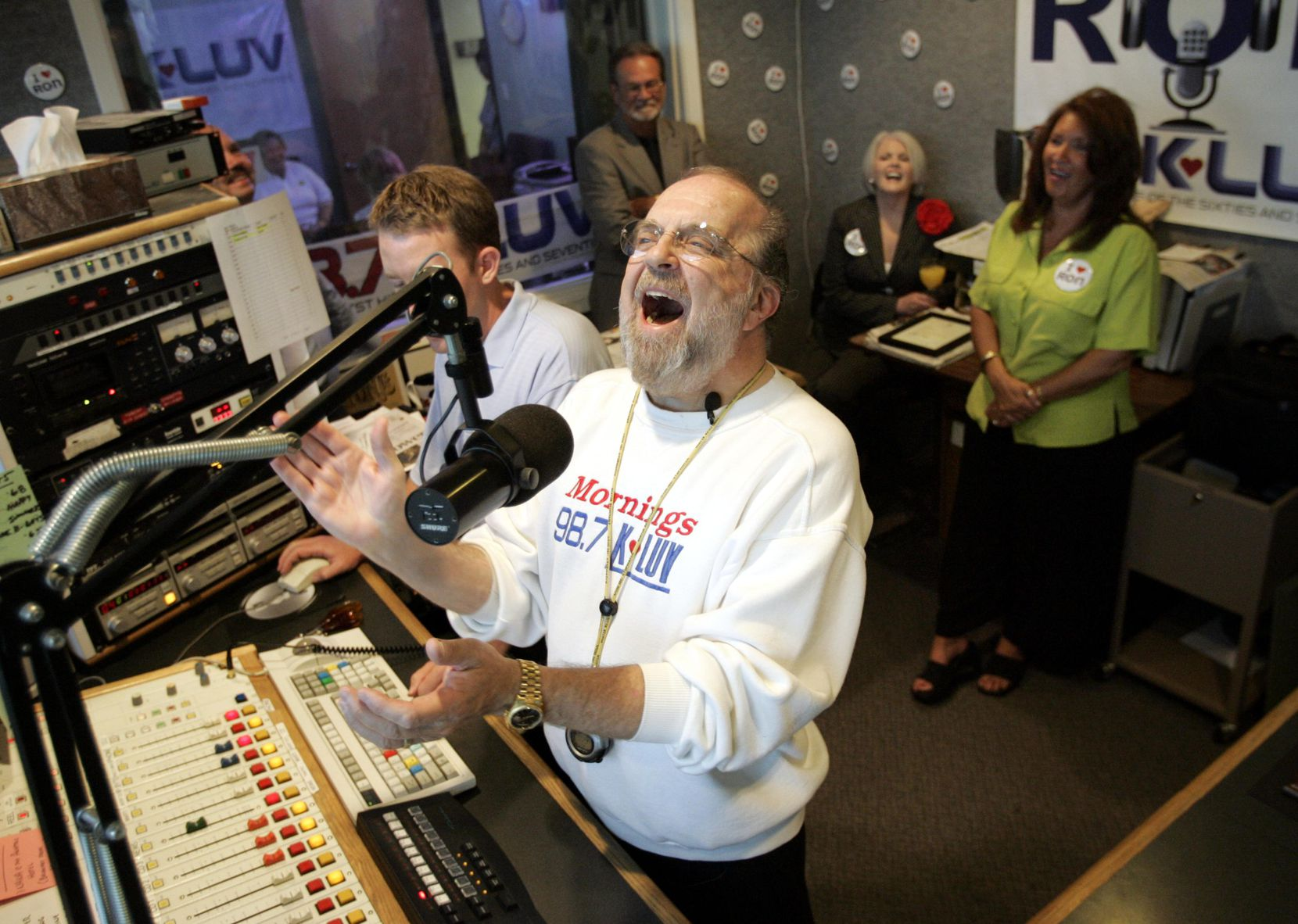 Radio personality Ron Chapman laughs at a comment made by a caller, as he hosts his final show for KLUV on Friday, June 24, 2005.