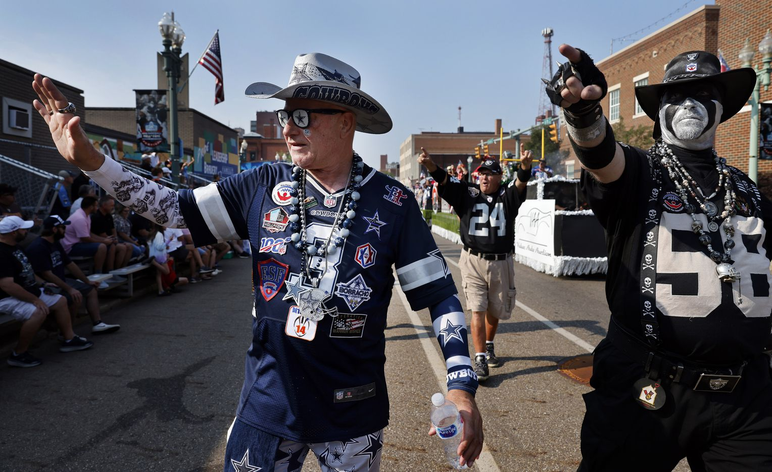 Dallas Cowboys fan Lloyd Wheeler of Fort Worth marches with other NFL mascots in the Canton Repository Grand Parade in downtown Canton, Ohio, Saturday, August 7, 2021. The Pro Football Hall of Fame parade honored newly elected and former members of the Hall, including newcomers and former Dallas Cowboys players Cliff Harris, Drew Pearson and head coach Jimmy Johnson. (Tom Fox/The Dallas Morning News)