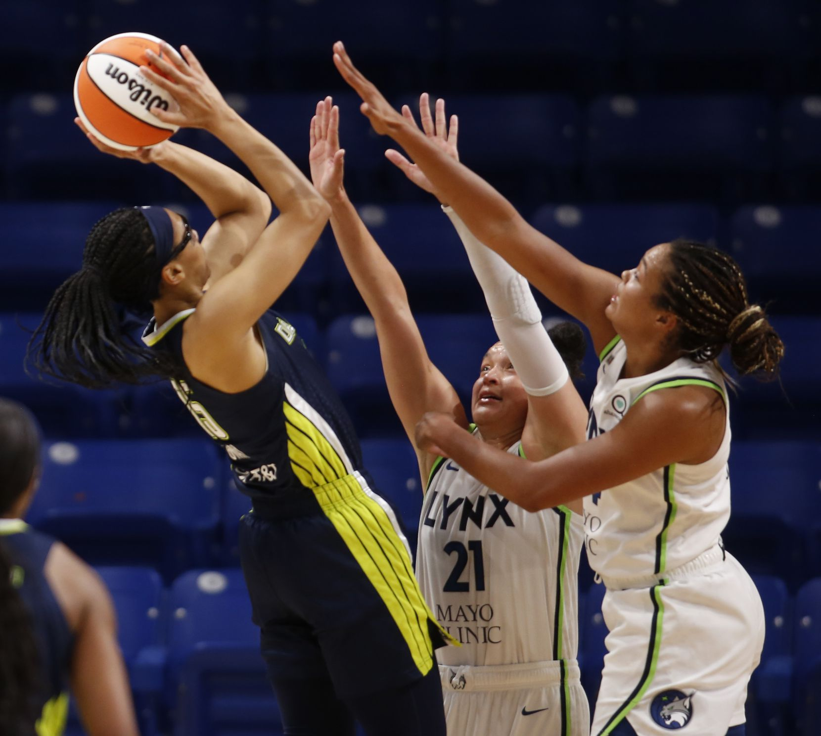 Dallas Wings guard Allisha Gray (15) goes up for a shot as she is double teamed by Minnesota Lynx guard Kayla McBride (21) and forward Napheesa Collier (24) during first quarter action. The two teams played their WNBA game at College Park Center on the campus of the University of Arlington on June 17, 2021(Steve Hamm/ Special Contributor)