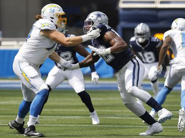 Dallas Cowboys defensive end Dorance Armstrong (92) had his hands full with Los Angeles Chargers offensive tackle Storm Norton (74) during the first quarter at SoFi Stadium in Inglewood, California, Sunday, September 19, 2021.