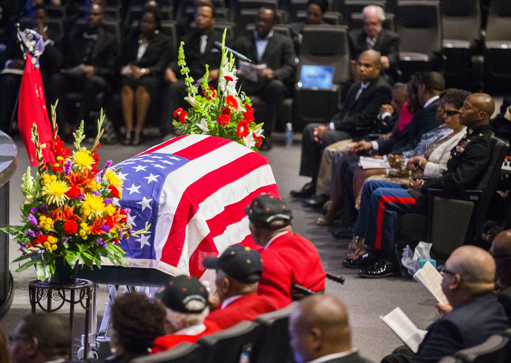 An American flag is draped over the casket of retired Army Air Corps 1st Lieutenant Calvin Spann during funeral services on Saturday, September 12, 2015 at Covenant Church in Carrollton, Texas.  Spann was an original Tuskegee Airman and fighter pilot with the 100th Fighter Squadron of the 332nd Fighter Group.  He served during World War II, when he flew 26 combat missions. (Ashley Landis/The Dallas Morning News)