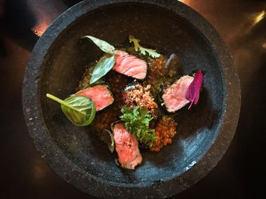 Betel-leaf-wrapped Mishima Reserve Wagyu beef with mint-balm chimichurri, smoked trout roe and fried shallots, a recent special at Mot Hai Ba; a slightly altered version has recently been added to the ever-changing menu.