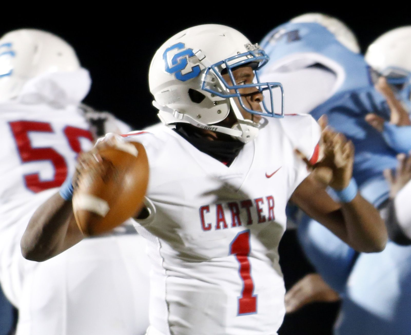 Dallas Carter quarterback Kace Williams (1) prepares to deliver a pass from the pocket during first quarter action against Wilmer Hutchins.  The two teams played their District 8-4A Division 1 football game at Wilmer Hutchins High School Stadium in Dallas on October 23, 2020. (Steve Hamm/ Special Contributor)
