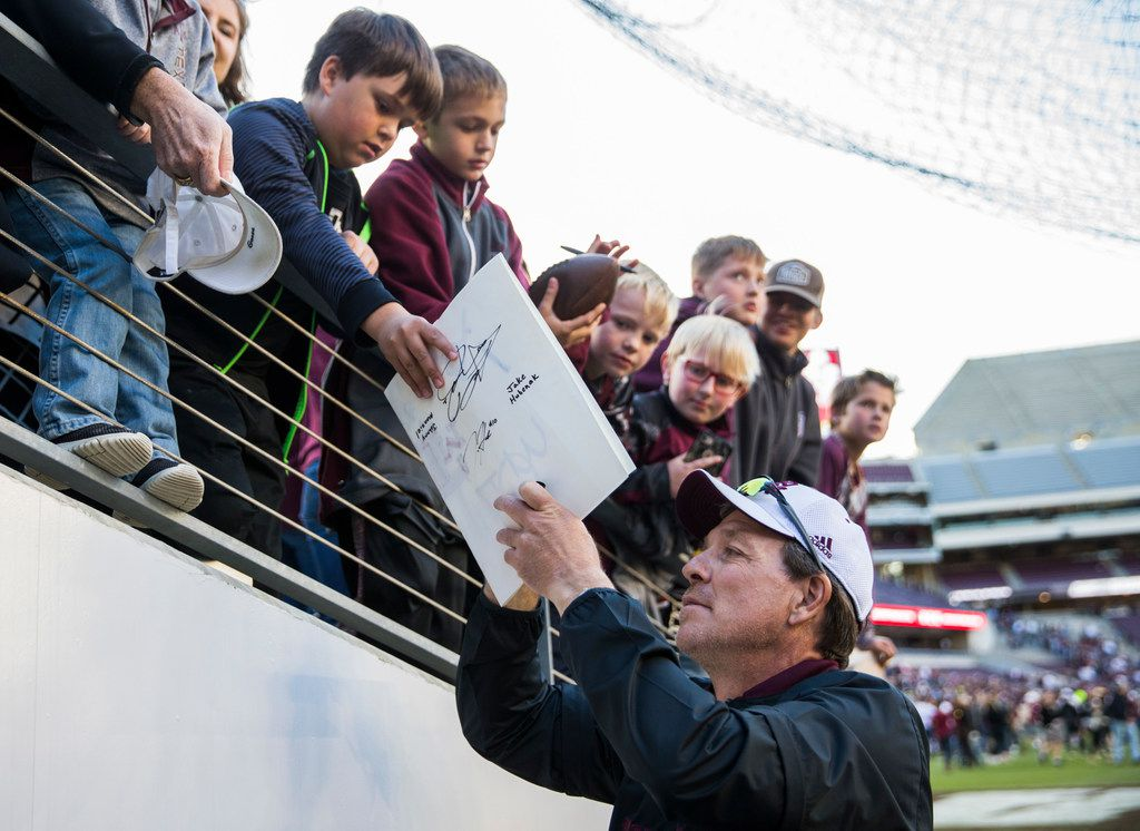 Texas A&M head coach Jimbo Fisher signs autographs after the Aggies' Maroon and White game on Saturday, April 14, 2018, at Kyle Field in College Station. (Ashley Landis/The Dallas Morning News)
