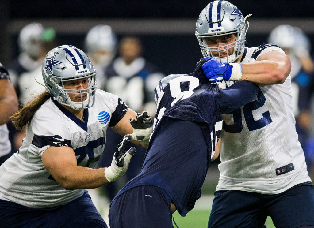 Defensive end Robert Quinn (58) and guard Connor Williams (52, right) collide during a Dallas Cowboys OTA practice on Wednesday, May 22, 2019 at The Star in Frisco. (Ashley Landis/The Dallas Morning News)