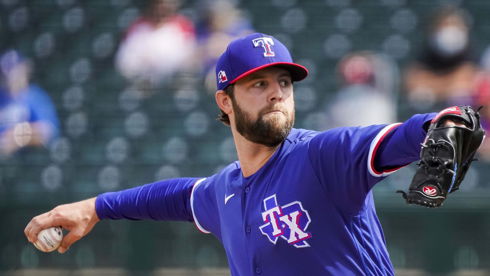 Texas Rangers pitcher Jordan Lyles delivers during the third inning of a spring training game against the Los Angeles Dodgers at Surprise Stadium on Sunday, March 7, 2021, in Surprise, Ariz.