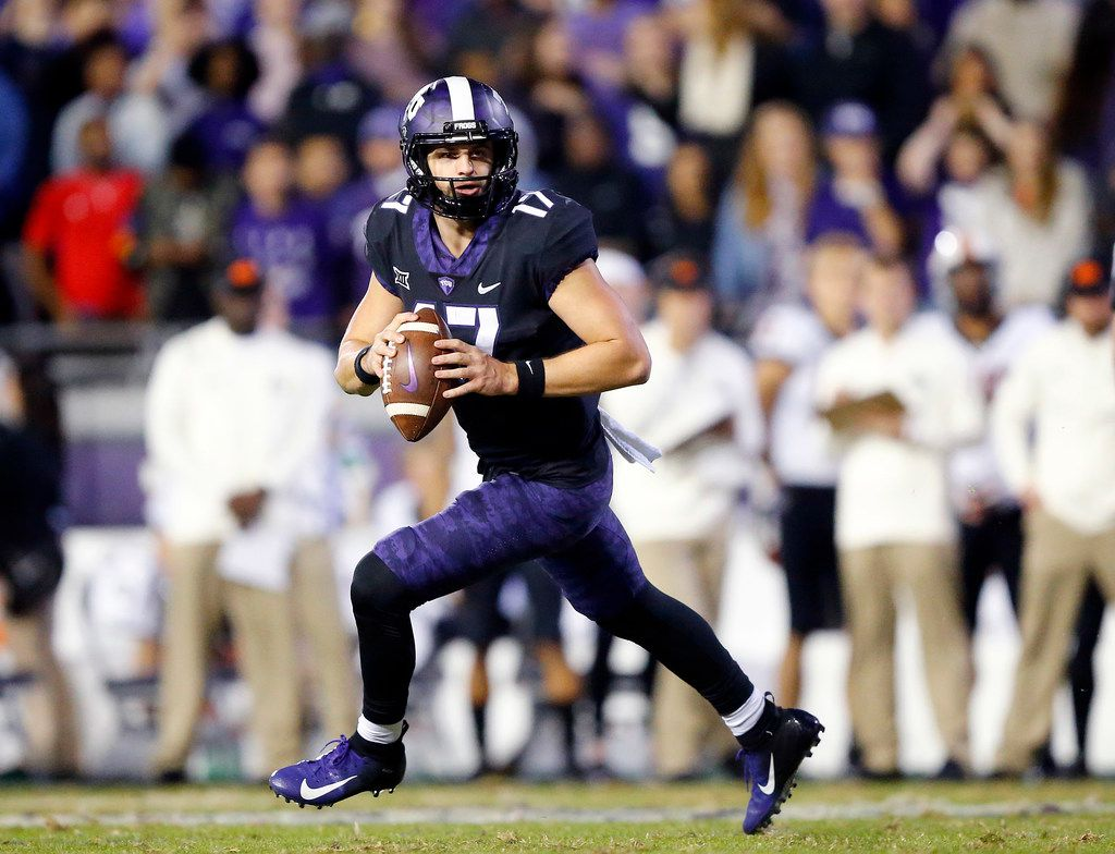 TCU Horned Frogs quarterback Grayson Muehlstein (17) rolls out looking for a receiver during the third quarter against the Oklahoma State Cowboys at Amon G. Carter Stadium in Fort Worth, Texas, Saturday, November 24, 2018. The Frogs hung onto win, 31-24. (Tom Fox/The Dallas Morning News)