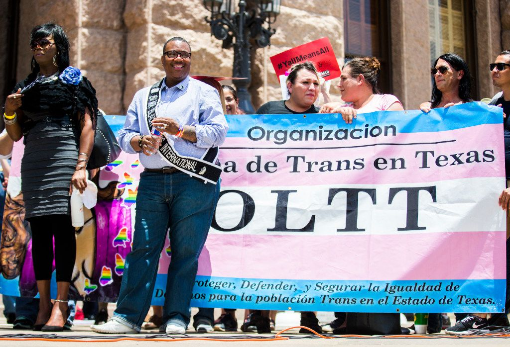 Trenton Johnson, Mr. Black Trans International, listened to speakers during a One Texas Resistance rally on the steps of the Capitol on the first day of a legislative special session in July 2017. At left is Carmarion Anderson, co-founder and president of Black Transwomen, Inc.