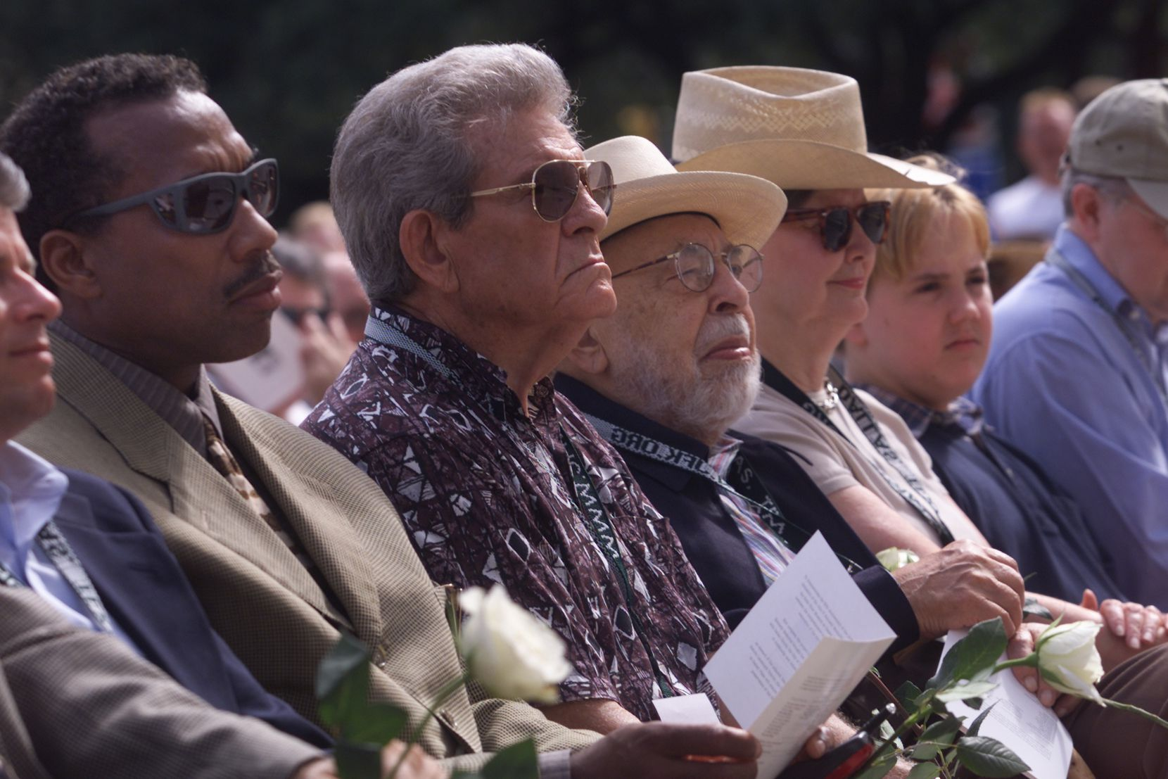 John Wiley Price, Jim Tyson, Stanley Marcus and others watch the rededication ceremony for the John Fitzgerald Kennedy Memorial in Downtown Dallas.