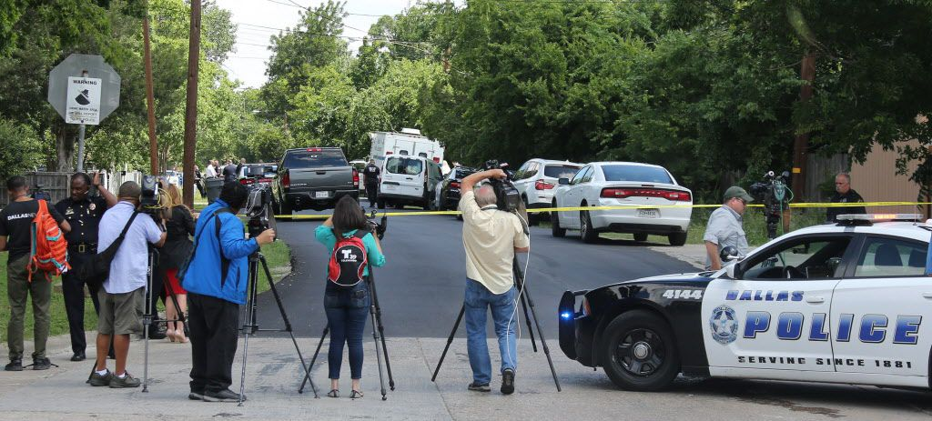 Dallas Police follow up at the scene of an officer-involved shooting at 8300 Reva Street in Dallas on Friday, May 12, 2017.