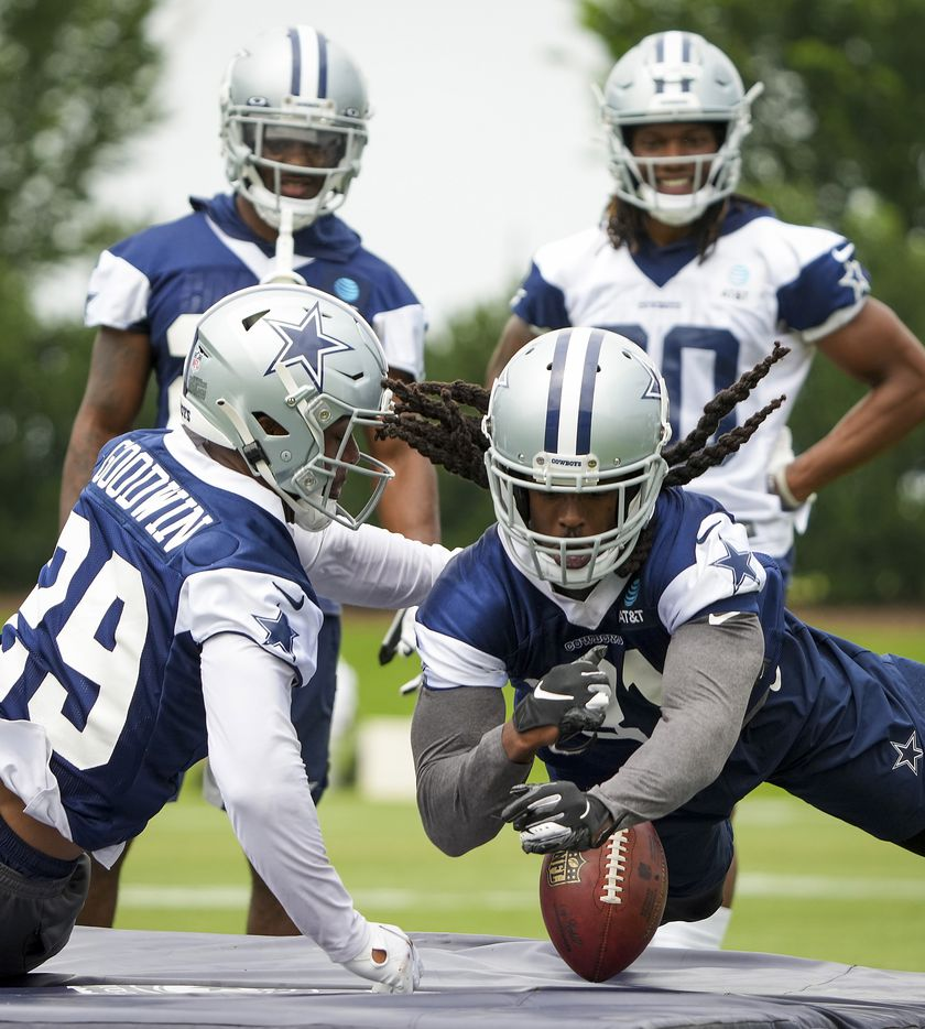 Dallas Cowboys cornerback Maurice Canady (31) loses the ball while participating in a fumble drill with cornerback C.J. Goodwin (29) during a minicamp practice at The Star on Wednesday, June 9, 2021, in Frisco. (Smiley N. Pool/The Dallas Morning News)