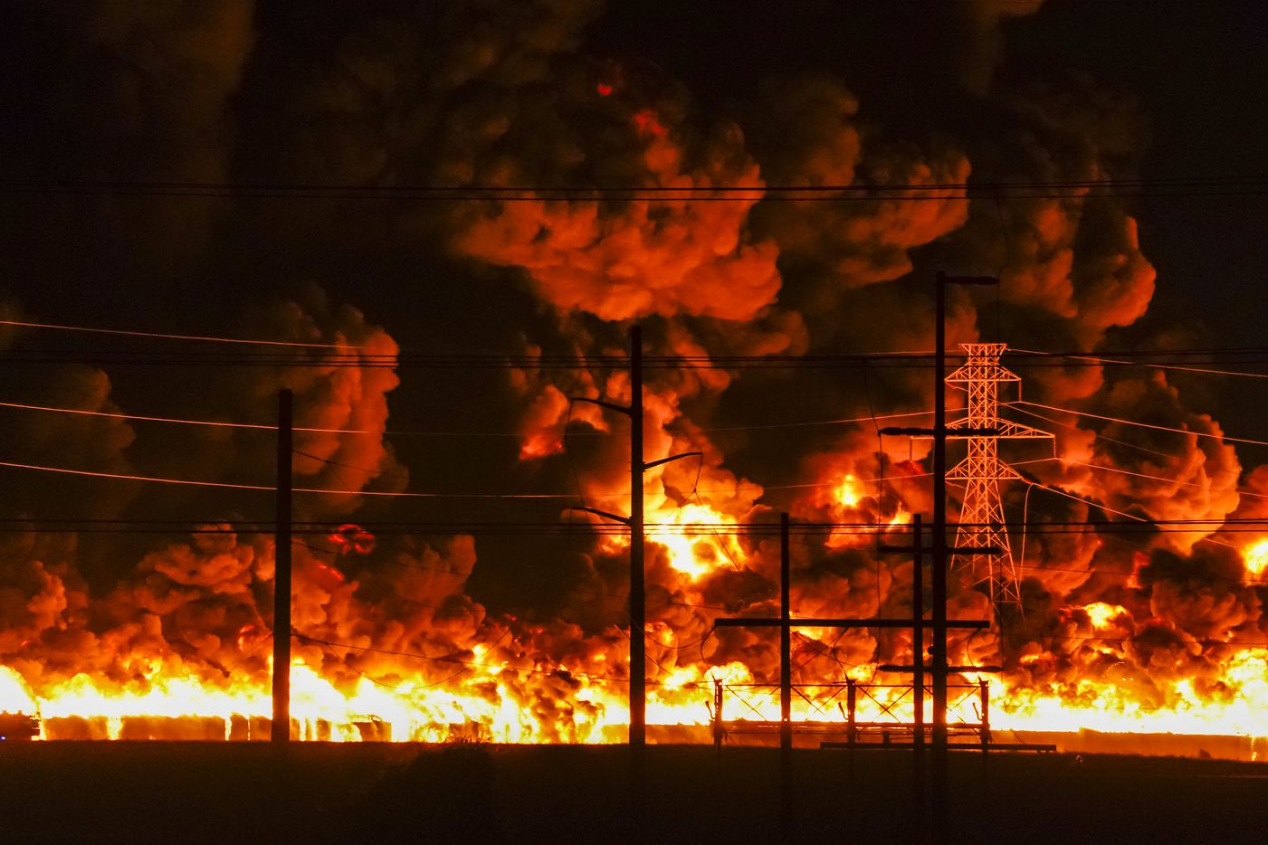 Flames erupt from a massive fire at  Poly-America on Wednesday, Aug. 19, 2020, in Grand Prairie.