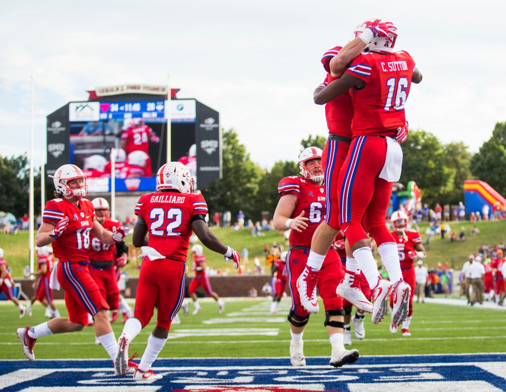 Southern Methodist Mustangs wide receiver Courtland Sutton (16) celebrates a touchdown with team mates during the fourth quarter of a football game between the University of Connecticut and SMU Texas on Saturday, September 30, 2017 at SMU's Ford Stadium in Dallas. (Ashley Landis/The Dallas Morning News)