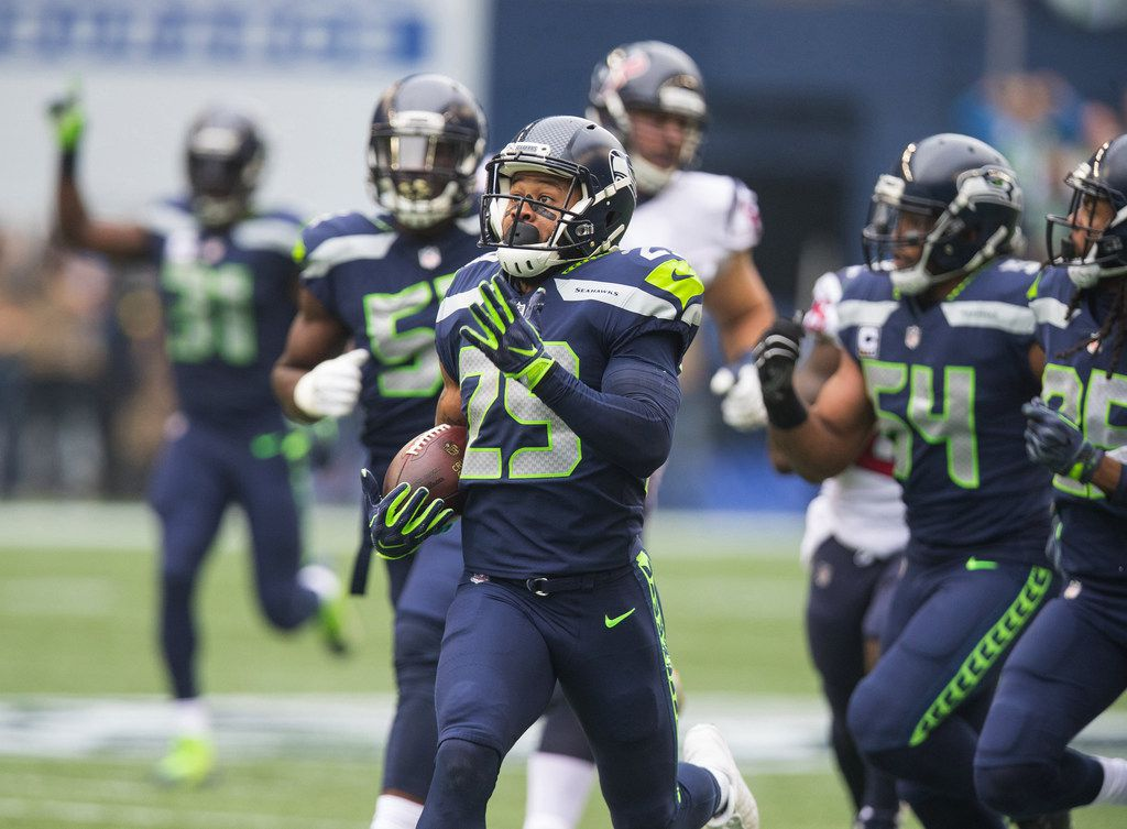 Seattle Seahawks free safety Earl Thomas (29) intercepts a Houston Texans quarterback Deshaun Watson pass and runs it back for a first quarter touchdown on Sunday, Oct. 29, 2017 at CenturyLink Field in Seattle, Wash. (Mike Siegel/Seattle Times/TNS)