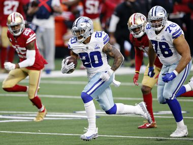 Cowboys running back Tony Pollard (20) breaks away from the 49ers defense en route to a fourth-quarter touchdown at AT&T Stadium in Arlington on Sunday, Dec. 20, 2020.