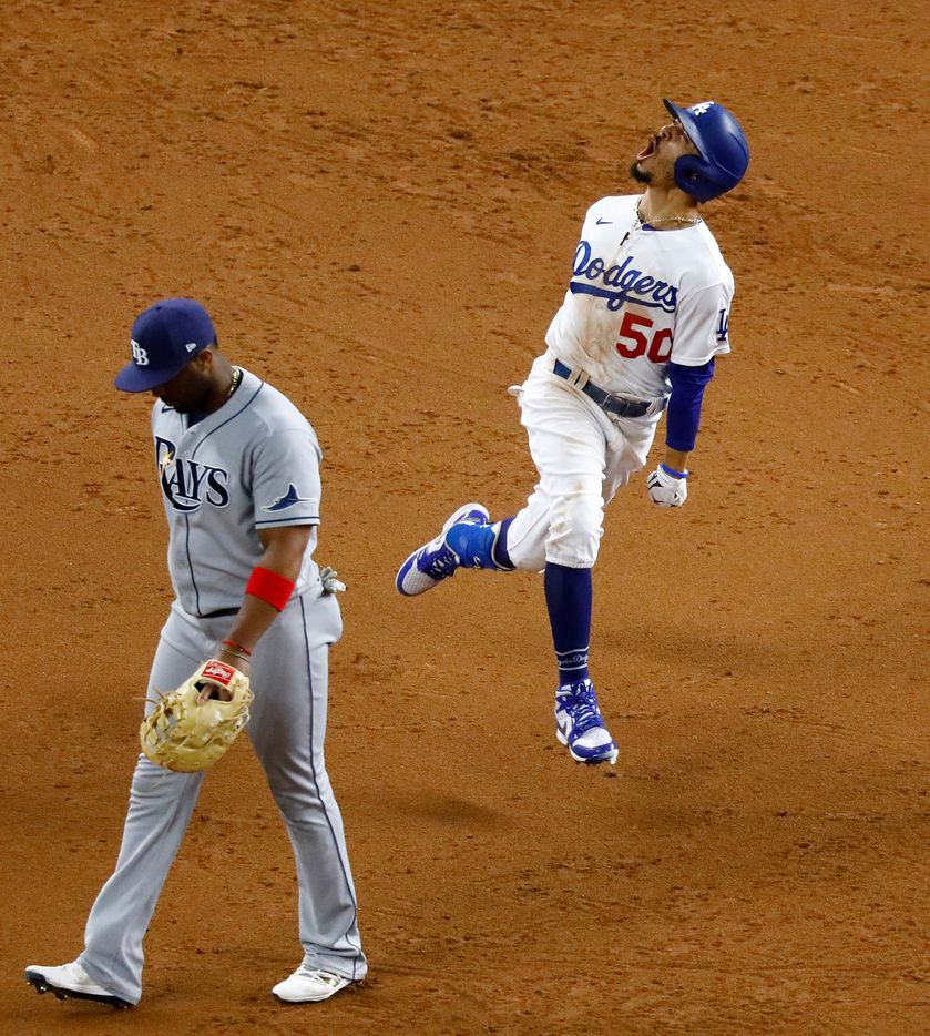 Los Angeles Dodgers Mookie Betts (50) reacts in front off Tampa Bay Rays first baseman Yandy Diaz (2) after hitting a solo home run during Game 6 of the World Series at Globe Life Field in Arlington, Tuesday, October 27, 2020. The Dodgers won the Championship game, 3-1.
