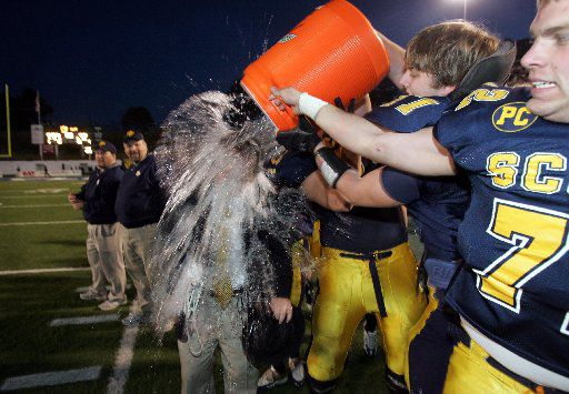 Highland Park coach Randy Allen gets dunked with gatorade after the Scots 59-0 victory in the 4A Division I State High School Football Championship game at the Rose Stadium in Tyler, TX on Saturday, December 10, 2005.
