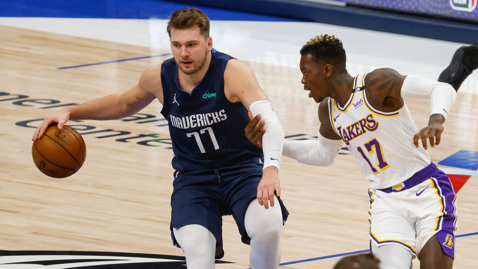 Dallas Mavericks guard Luka Doncic (77) is guarded by Los Angeles Lakers guard Dennis Schroder (17) during the first quarter at the American Airlines Center on Saturday, April 24, 2021, in Dallas.