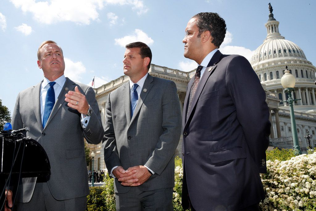 Rep. Jeff Denham, R-Calif., left, speaks next to Rep. David Valadao, R-Calif., and Rep. Will Hurd, R-Texas, during a news conference with House Republicans who are collecting signatures on a petition to force House votes on immigration legislation, Wednesday, May 9, 2018, on Capitol Hill in Washington.