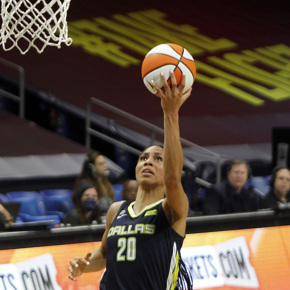 Dallas Wings forward Isabelle Harrison (20) finishes a Wings fast break uncontested for two of her 2nd half points in their game against the Chicago Sky. Dallas lost to Chicago 91-81. The two WNBA teams played their game at College Park Center in Arlington on June 30, 2021. (Steve Hamm/ Special Contributor)