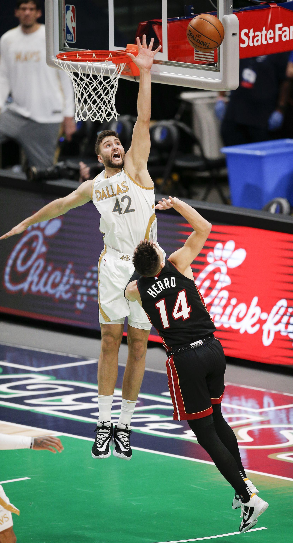 Miami Heat guard Tyler Herro (14) attempts a shot as Dallas Mavericks forward Maxi Kleber (42) defends during the second half of an NBA basketball game, Friday, January 1, 2021. (Brandon Wade/Special Contributor)