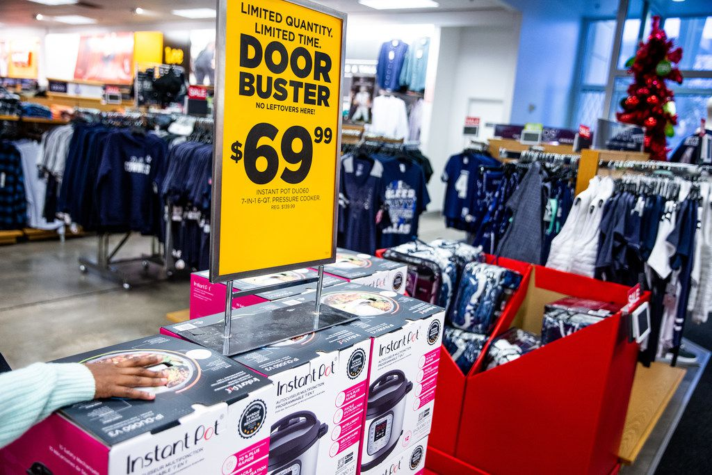 A customer looks at an Instant Pot during Black Friday shopping at Kohl's in Plano.