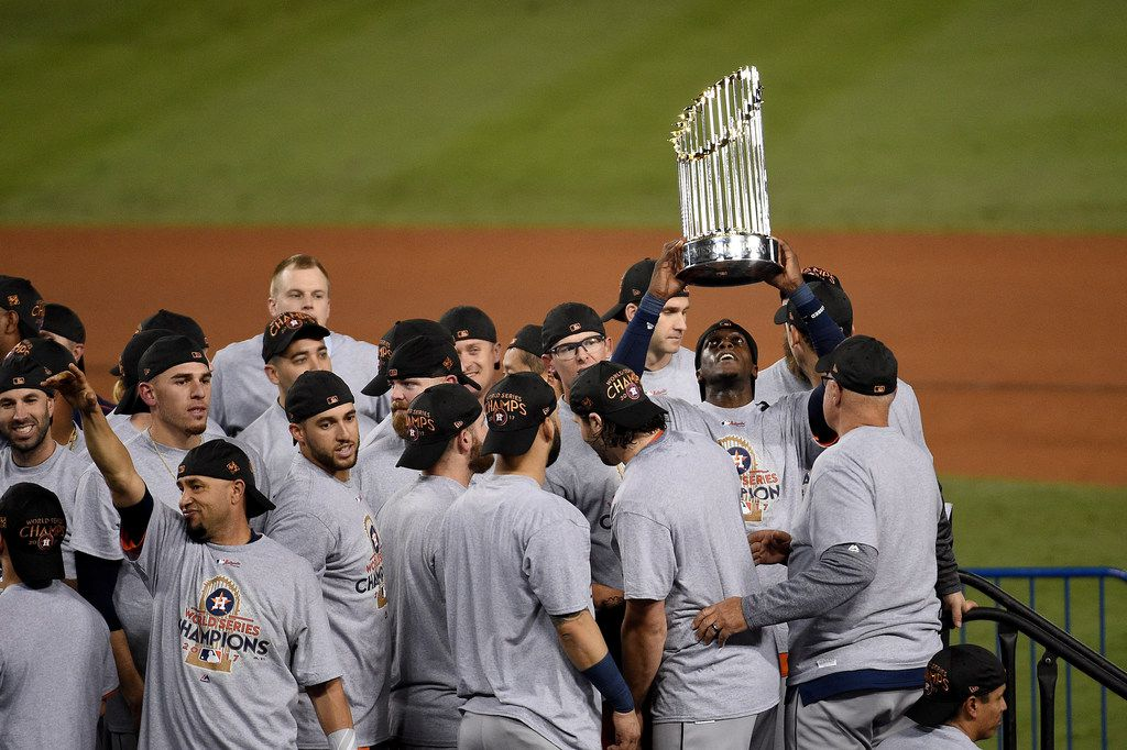 LOS ANGELES, CA - NOVEMBER 01:  Cameron Maybin #3 of the Houston Astros holds the Commissioner's Trophy after defeating the Los Angeles Dodgers 5-1 in game seven to win the 2017 World Series at Dodger Stadium on November 1, 2017 in Los Angeles, California.  (Photo by Kevork Djansezian/Getty Images)