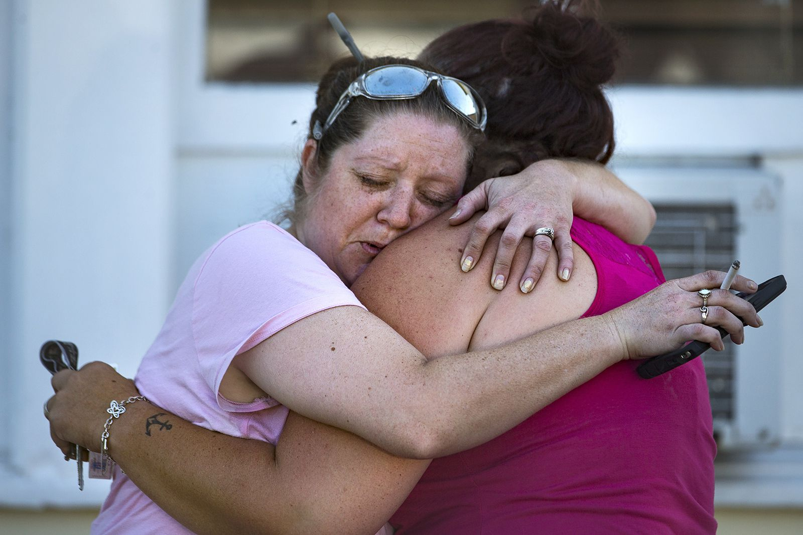 Carrie Matula embraces a woman after the mass shooting at First Baptist Church in Sutherland Springs. Matula said she heard the shooting from the gas station where she works a block away.