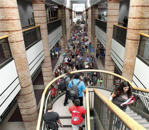 Students file through the halls of Allen High School, where the campus stretches almost a quarter of a mile.