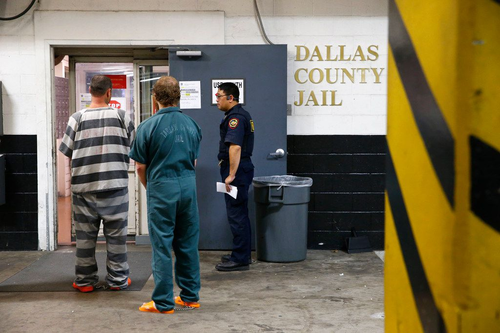 An inmate is booked into the Dallas County Jail in this file photo.