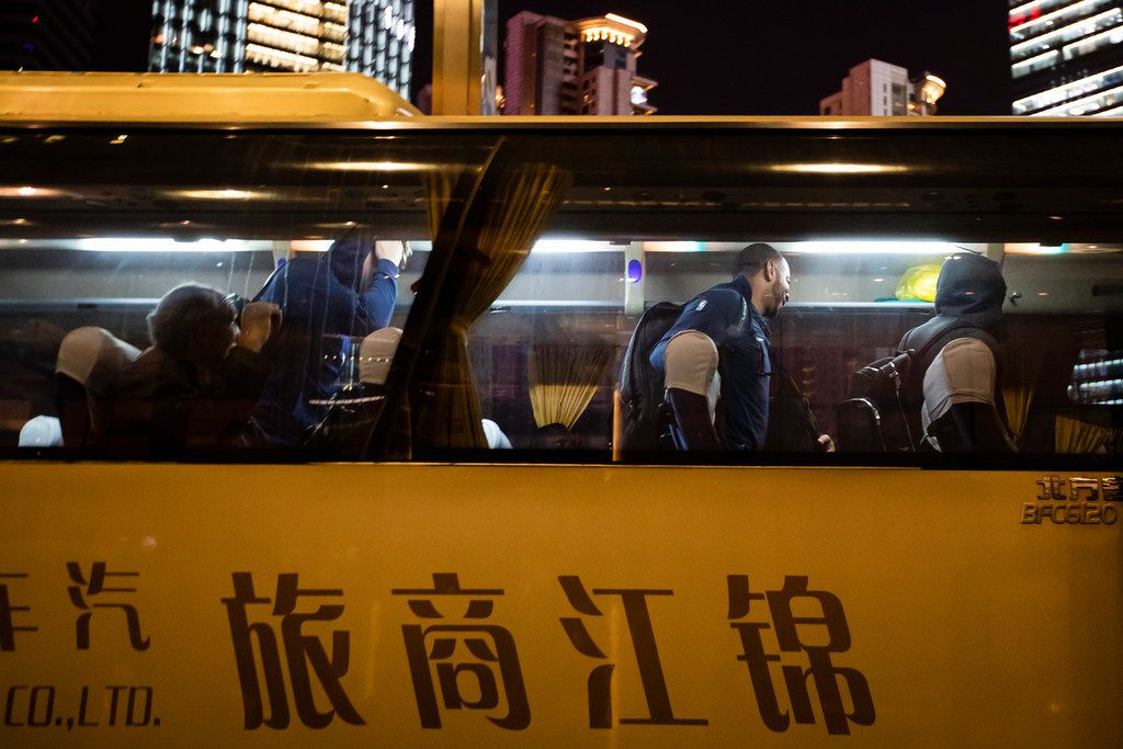 Dallas Mavericks players, including guard Devin Harris (center) exit the team buses as they arrive at their hotel on Tuesday, Oct. 2, 2018, in Shanghai. The Dallas Mavericks will face the Philadelphia 76ers in Shanghai on Oct. 5th in the first of two NBA China Games 2018 preseason basketball games. (Smiley N. Pool/The Dallas Morning News)
