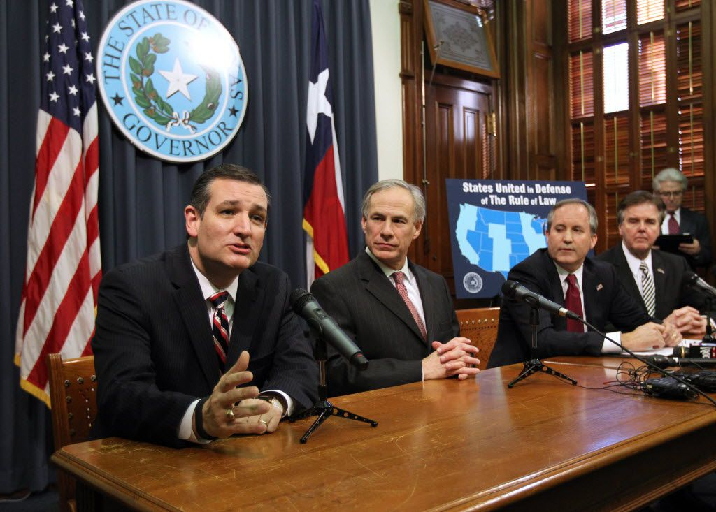U.S. Sen. Ted Cruz (left) and Texas Attorney General Ken Paxton (second from righ), are waging a battle against the Obama administration over a plan to transfer control from the U.S. over internet domain names. The duo is seen here last year at a news conference in Austin with Gov. Greg Abbott and Lt. Gov. Dan Patrick.