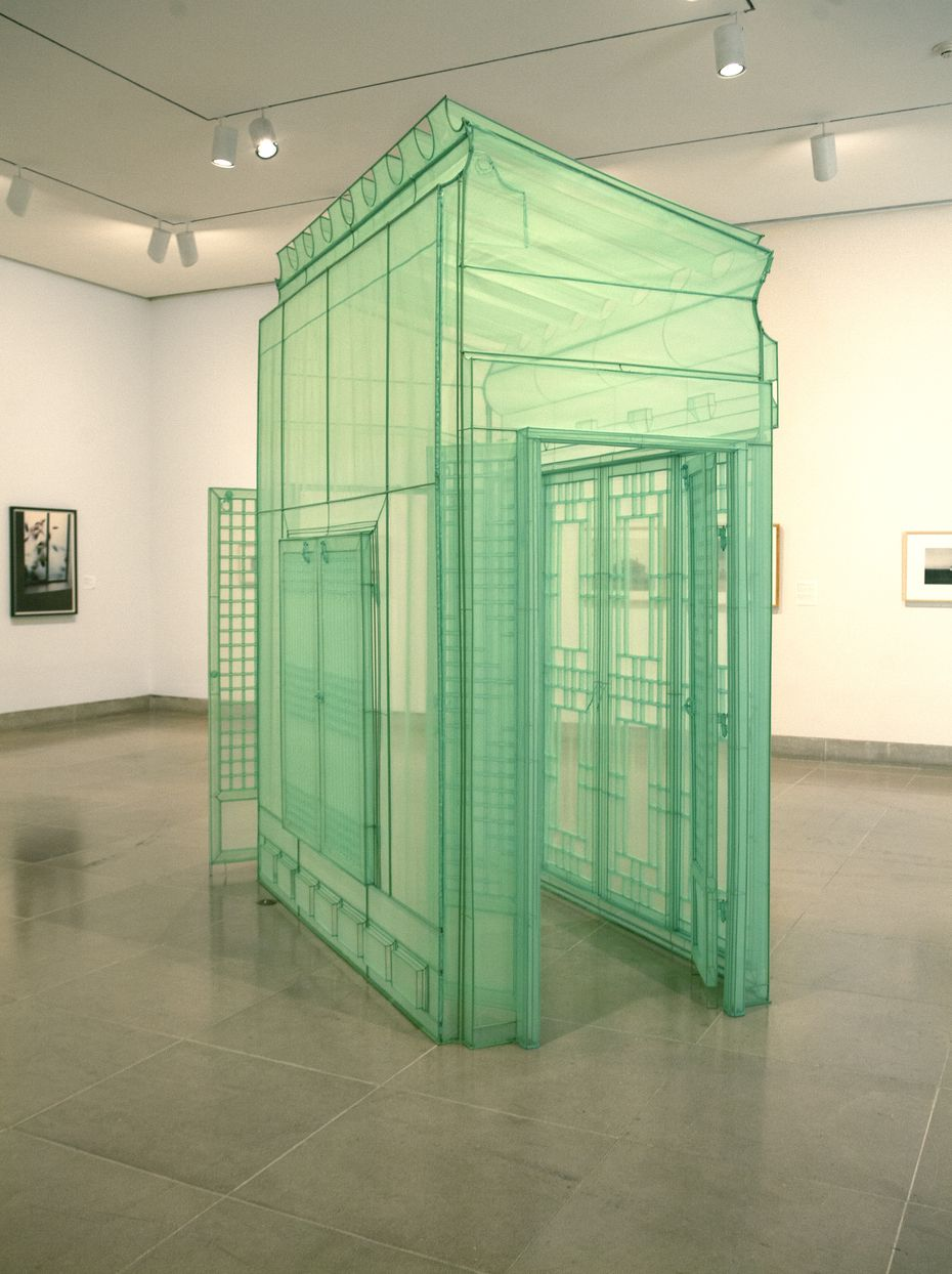 Do Ho Suh's 2016 replica of an entrance to his childhood home in Korea is made entirely of precisely cut and draped transparent polyester fabric over a stainless-steel frame.