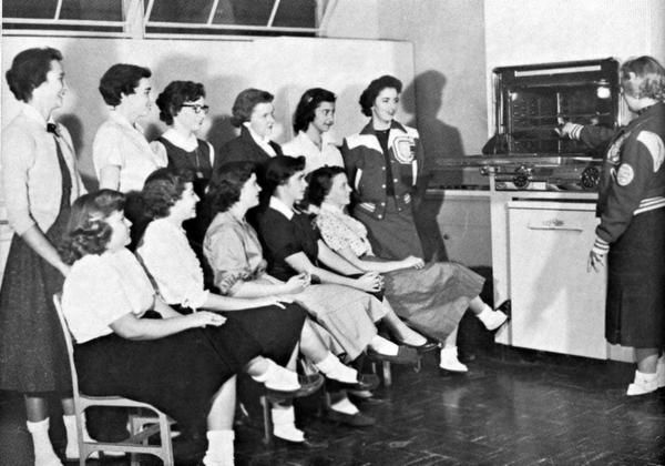 The first high school also included a home-economics room for women, a first for the students.