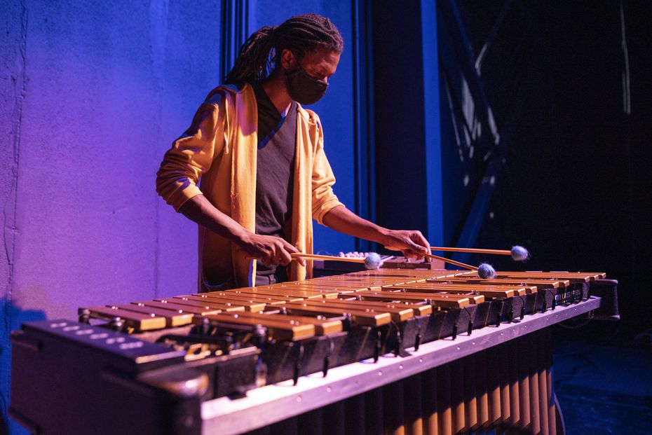 "Composer-musician Nigel Newton plays the vibraphone in ""The Cube."""