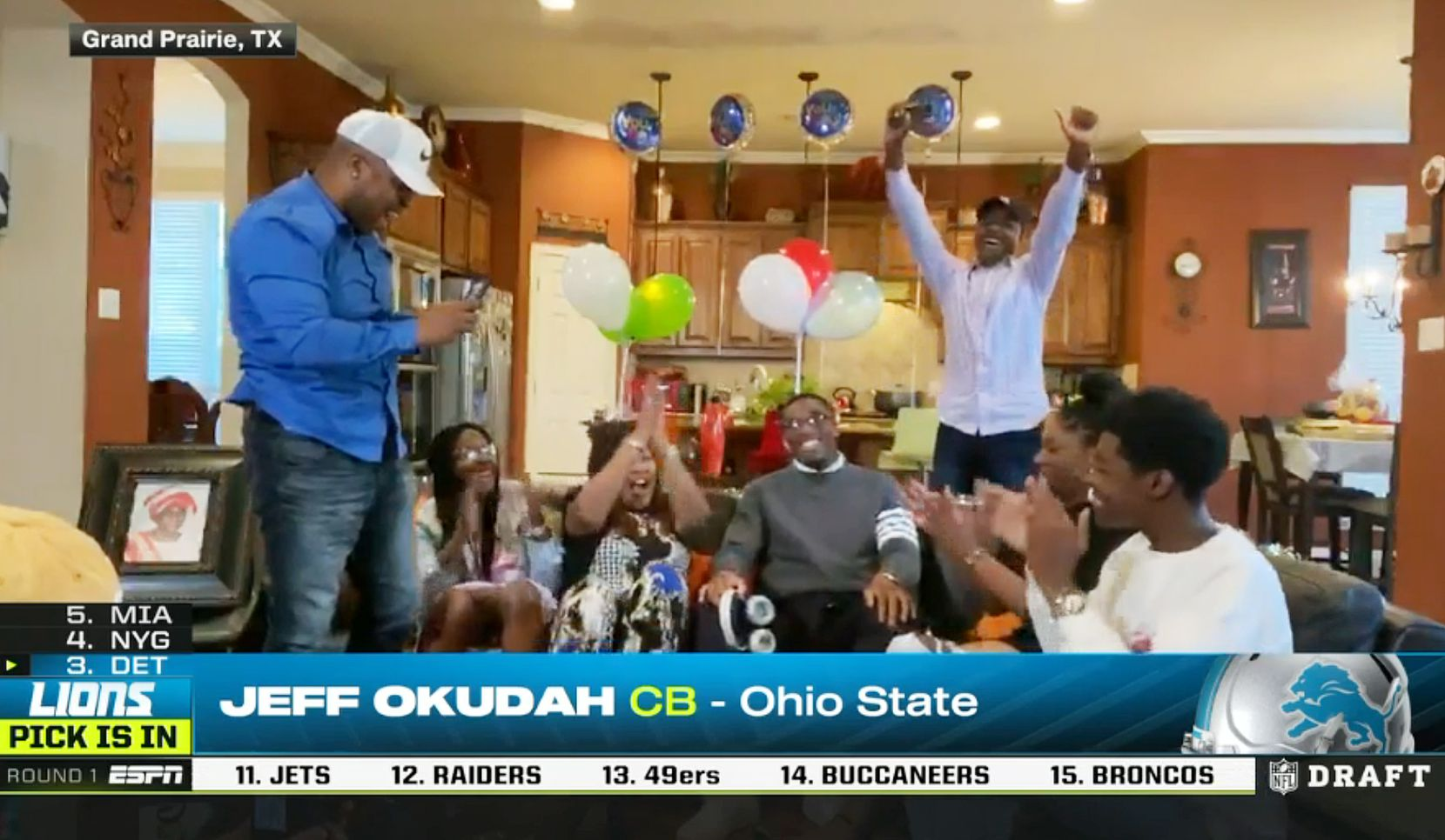 Screen capture of the Detroit Lions third pick in the first round of the NFL Draft, cornerback Jeff Okudah, of Ohio State with family in Grand Prairie, Texas on Thursday, April 23, 2020. Okudah played at South Grand Prairie High School before attending Ohio State. Due to the coronavirus pandemic the NFL Draft was held virtually. (ESPN)