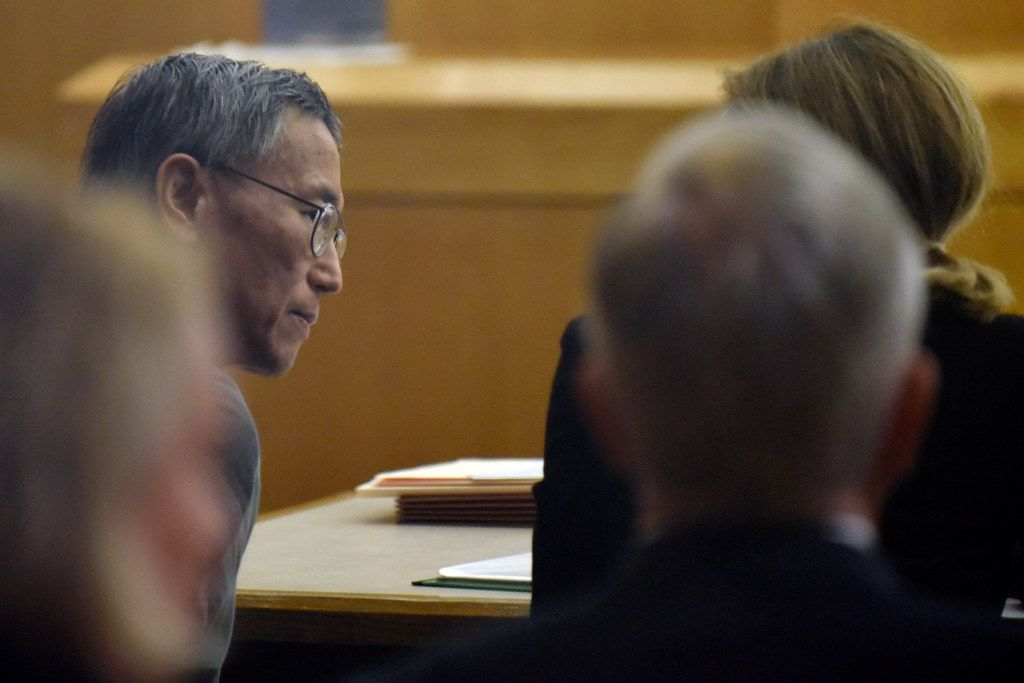 George Guo, left, speaks with an attorney before the start of his hearing at the 194th District Court inside the Frank Crowley Courts Building in Dallas, Friday morning Aug. 02, 2019. Guo will stand trail for the death of a woman who died from injuries she suffered 30 years after being attacked and raped in Highland Park.