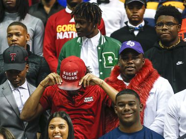 Players gather for a group photo during a Dallas ISD signing day event at Ellis Davis Field House on Wednesday, Feb. 5, 2020 in Dallas.