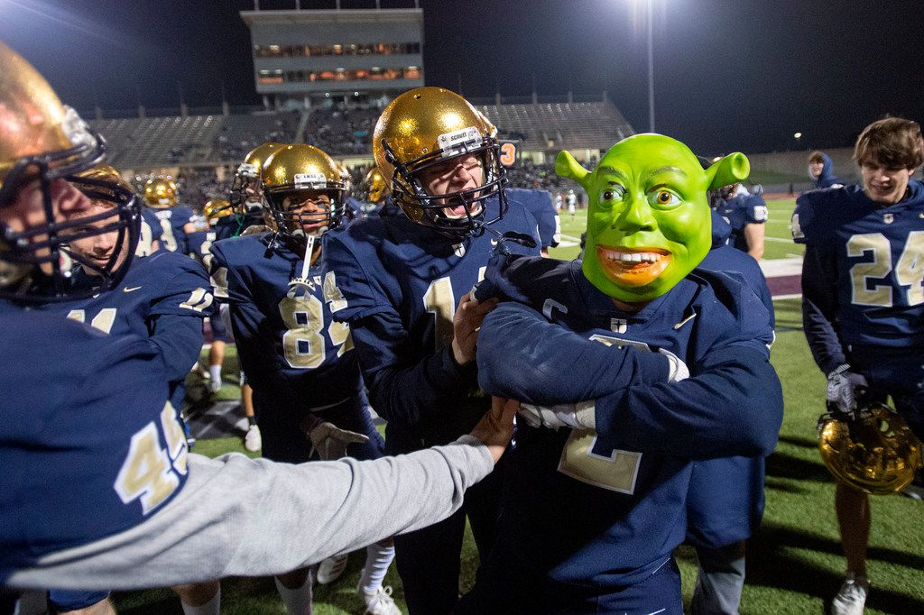 Jesuit senior defensive back Jhalen Spicer (2) celebrates with teammates while wearing a Shrek mask after making an interception in the first half of an area round high school football playoff game against Longview on Friday, November 22, 2019 at John Kincaide Stadium Dallas. (Jeffrey McWhorter/Special Contributor)