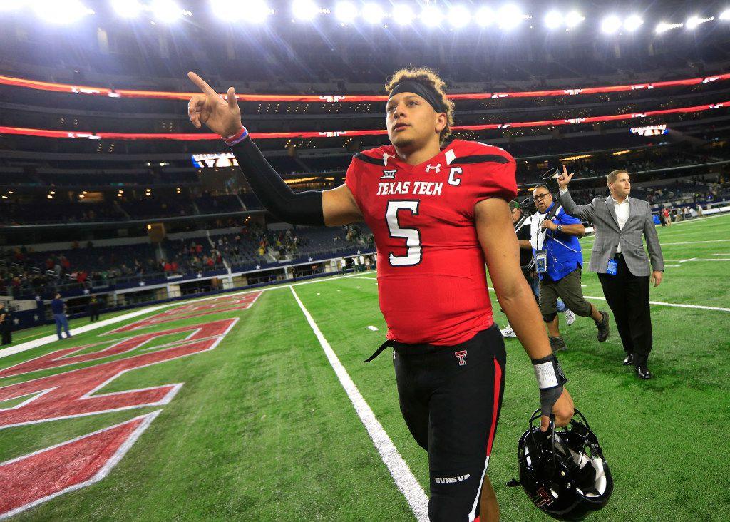 Texas Tech quarterback Patrick Mahomes II celebrates after Tech defeated Baylor in an NCAA college football game Friday, Nov. 25, 2016, in Arlington, Texas. (AP Photo/Ron Jenkins)