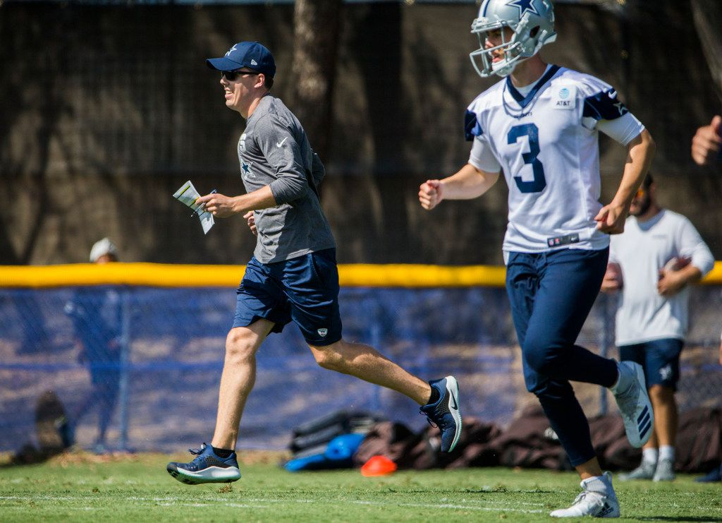 Dallas Cowboys offensive coordinator Kellen Moore runs alongside quarterback Mike White (3) during an afternoon practice at training camp in Oxnard, California on Sunday, July 28, 2019. (Ashley Landis/The Dallas Morning News)