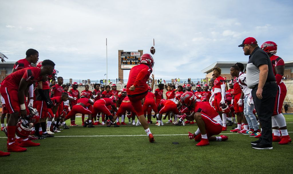 Cedar Hill players cheer on kicker Max Mata (89) as he warms up before a high school football game between Allen and Cedar Hill on Friday, August 30, 2019 at Eagle Stadium in Allen. (Ashley Landis/The Dallas Morning News)