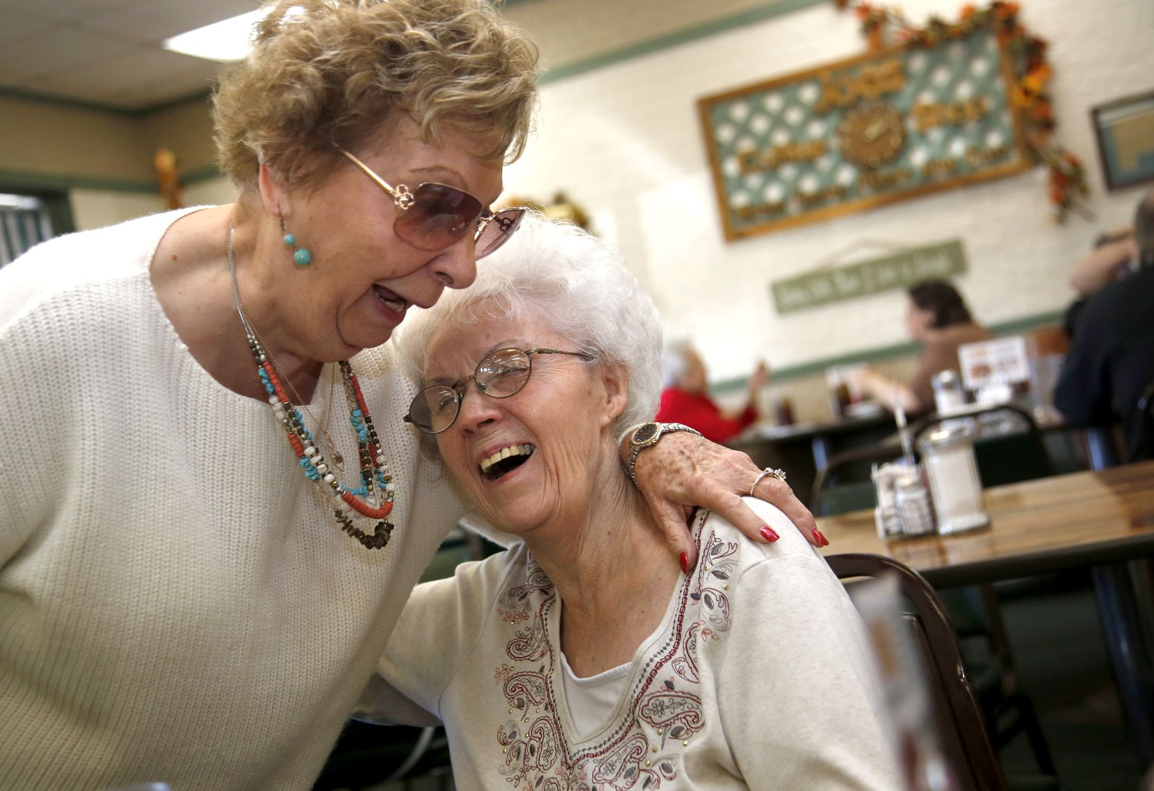 Carol Wood (right), owner of Joe's Coffee Shop, receives a hearty hug from longtime friend Jolene Lear at Joe's Coffee Shop Nov. 10, 2016 in Irving, Texas.