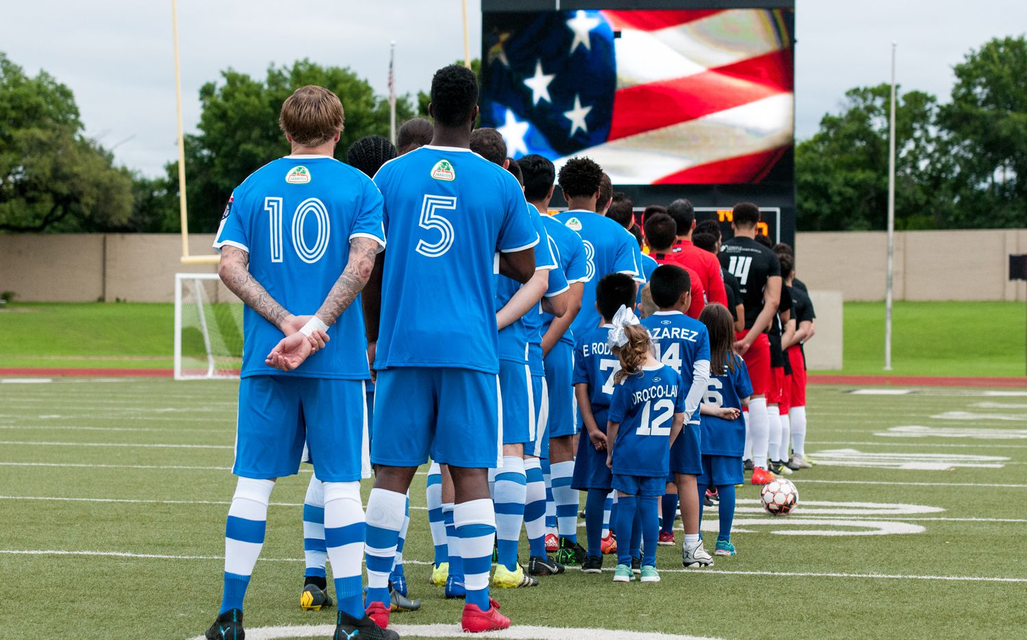 Fort Worth Vaqueros stand for the National Anthem at a home game against Tyler FC.