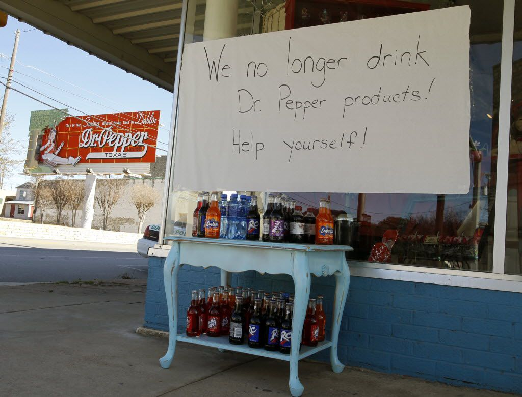 A sign out in front of Three Sisters of Dublin gift shop one block from Dr Pepper Bottling Co. of Dublin relays some sentiments of the town on the last day to get Dublin Dr Pepper on Jan. 12, 2012.  (File Photo/Nathan Hunsinger/The Dallas Morning News)