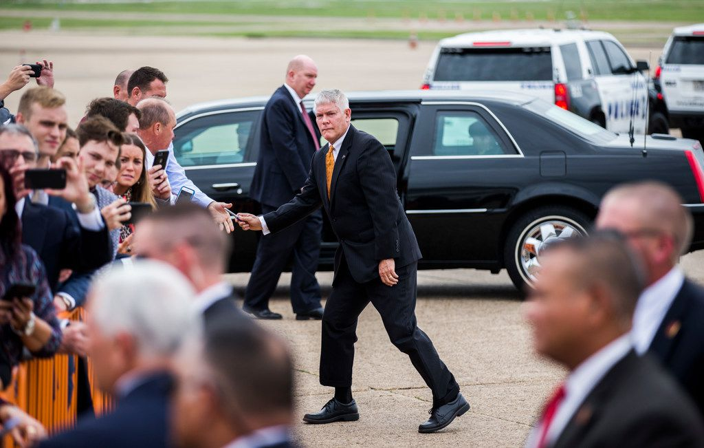 U.S. Representative Pete Sessions returns a pen to a supporter after he and Vice President Mike Pence exited Air Force Two in Dallas on Monday, October 8, at Love Field Airport in Dallas. Pence will attend a Pete Sessions for Congress event and a Ted Cruz for Senate event before flying to Missouri later today. (Ashley Landis/The Dallas Morning News)