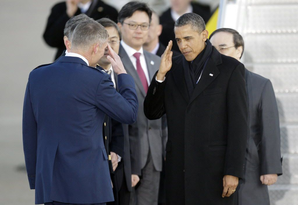 President Barack Obama salutes upon arrival at Osan Air Base to attend the Nuclear Security Summit, in Osan, south of Seoul, South Korea, Sunday, March 25, 2012.