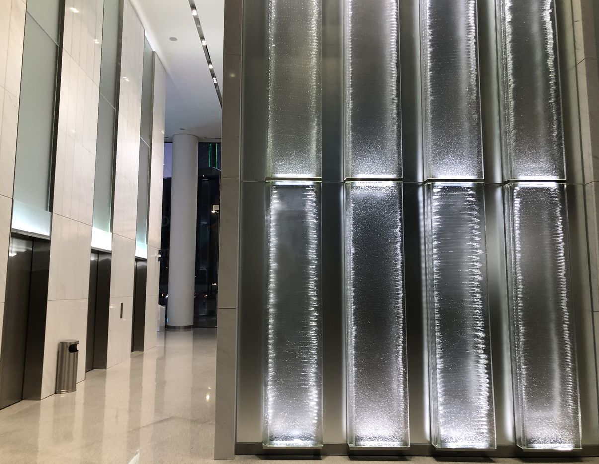 The most striking feature of the remodeling are yards of lighted glass panels in the lobby.